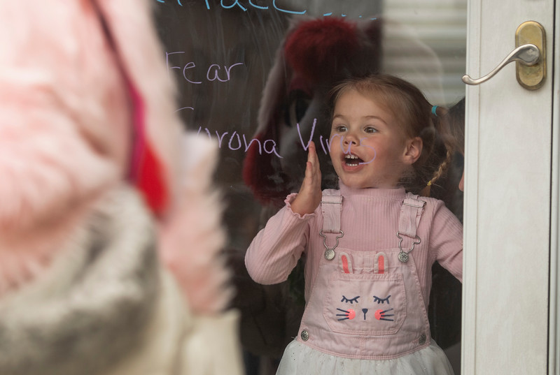Addi Lukasiewicz, 2, reacts to seeing the Easter Bunny as he made house calls on Easter during the coronavirus pandemic in Fort Collins, Colo. on Friday, March 10, 2020.
