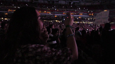 Olivia watching the concert
