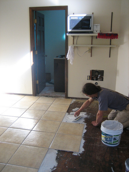 Eric tiling our studio in Prunedale