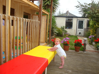 Isla approves of the new benches that Dad made. Now she can get all the way from the back door to her house without crawling!