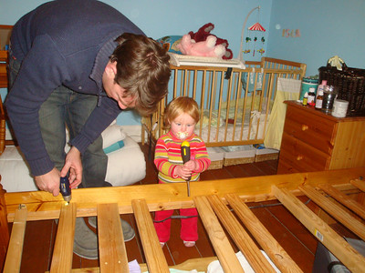 Isla helps with the screwing, last time for this bed...