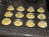 Putting the last of the mix on top. Making corn muffin pot pies, 08/08/2012