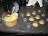 Putting Jiffy mix in the muffin tins. Making corn muffin pot pies, 08/08/2012