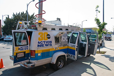 Photos from Community Open House and Ribbon Cutting for 210 4-03-2008. Channel 30 Action News truck outside 210 building.