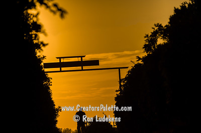 Sun setting beyond the entrance to La Belle Winery
