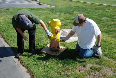 Painting Fire Hydrants - photo by Dan Cloutier