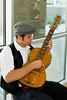 "Special Portuguese 15 string guitar.<br /> Image taken at Tulare City Library ""Coffeehouse Jam"" fundraiser for Tulare Read."