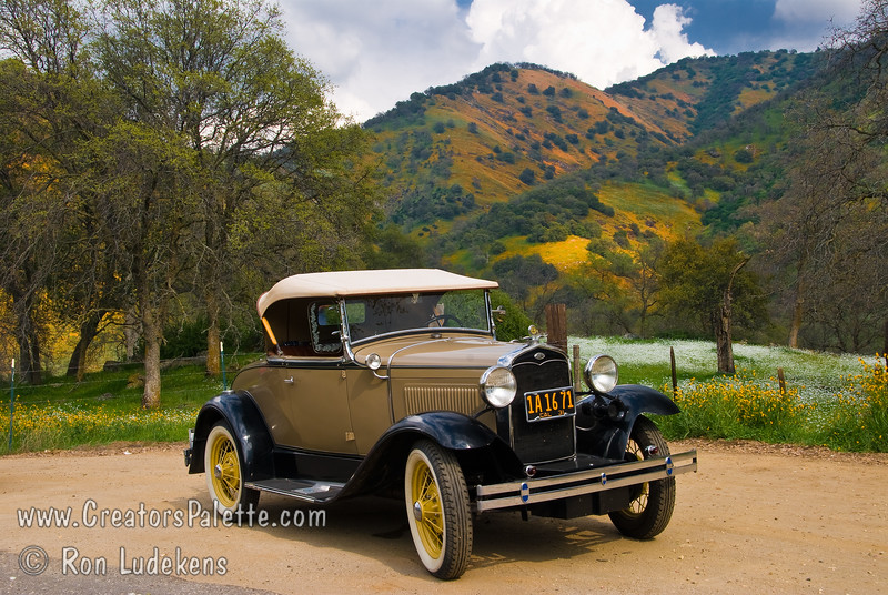 An added treat on this photo journey was to see this collection of beautiful antique cars traveling down the road.<br /> Scenes along Dry Creek Drive in Tulare County Foothills.  A storm was brewing but the sunshine periodically popped through the clouds for dramatic lighting on beautiful hillside views.