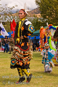 Photo taken at Tule River 2007 Pow Wow on September 22, 2007 at McCarthy Ranch, Porterville, CA.   Dancers in Grand Entrance Parade. Genevieve Lemaster #223 - Jingle Dancer later won first place.