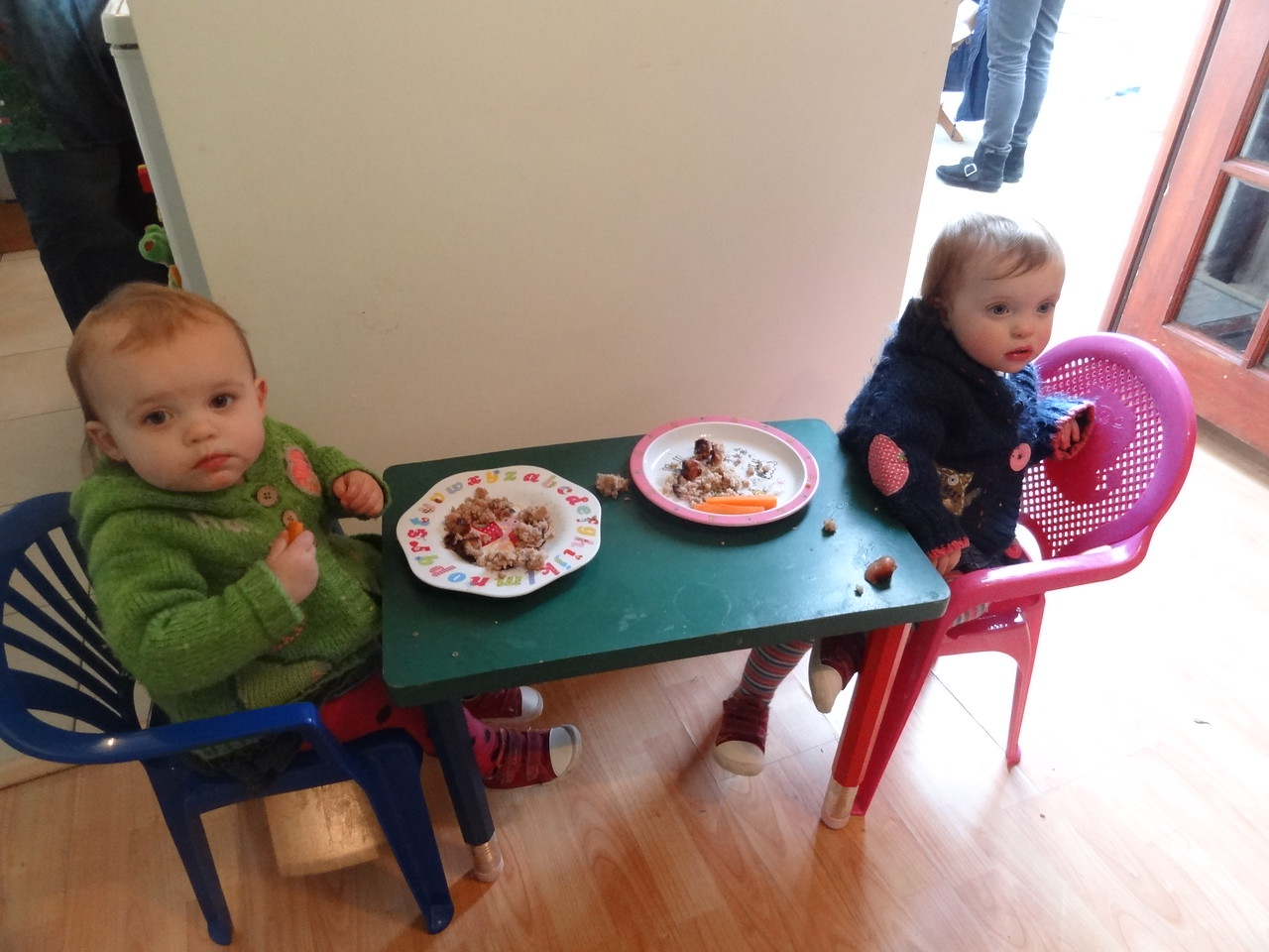 Layla and Polly demolish their sausages