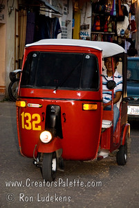 Guatemala Mission Trip - Day 2 -  Saturday, November 10, 2007 These little 3 wheel vehicles carry tourists and are called Tuk Tuks.  Going down main market street in Panachel.