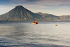 Guatemala Mission Trip - Day 3 -  Sunday, November 11, 2007<br /> Early Morning along shore of Lake Atitlan in Panajachel.   Boat is taking a large orange bouy out into the lake for the swimmers to race around.  San Pedro Volcano wirh city of San Pedro to the right of it.