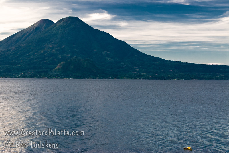 Guatemala Mission Trip - Day 3 -  Sunday, November 11, 2007<br /> Sunrise and Early Morning along shore of Lake Atitlan in Panajachel.   Two volcanoes - Toliman in front with Atitlan behind it.