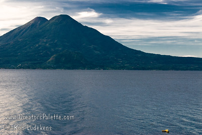 Guatemala Mission Trip - Day 3 -  Sunday, November 11, 2007 Sunrise and Early Morning along shore of Lake Atitlan in Panajachel.   Two volcanoes - Toliman in front with Atitlan behind it.