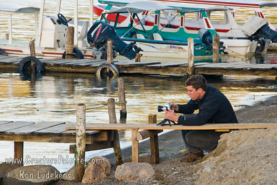 Guatemala Mission Trip - Day 4 - Monday, November 12, 2007 Tanner Boley taking photos of sunrise at Lake Atitlan in Panajachel Guatemala.