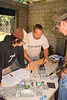 Guatemala Mission Trip - Day 4 - Monday, November 12, 2007<br /> Jordan getting instructions from Mike and David on assembling the electrical components of the water filtration system.