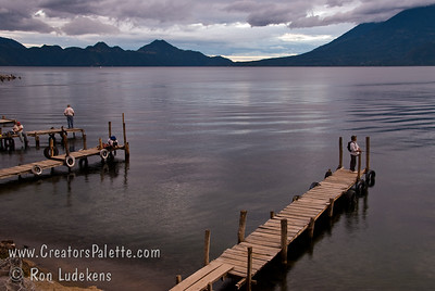 Guatemala Mission Trip - Day 5 -  Tuesday, November 13, 2007 Sunset over Lake Atitlan from Panajachel, Guatemala.  Fisherman on dock.  Flank of Toliman and Atitlan Volcanoes on right.