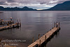 Guatemala Mission Trip - Day 5 -  Tuesday, November 13, 2007<br /> Sunset over Lake Atitlan from Panajachel, Guatemala.  Fisherman on dock.  Flank of Toliman and Atitlan Volcanoes on right.