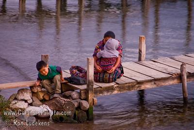 Guatemala Mission Trip - Day 5 -  Tuesday, November 13, 2007  A Guatemalan lady and children at sunset on the dock on Lake Atitlan by Panajachel, Guatemala.