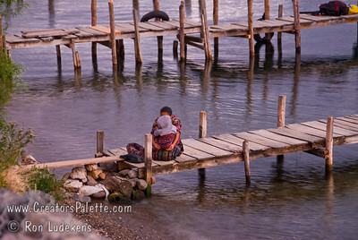 Guatemala Mission Trip - Day 5 -  Tuesday, November 13, 2007  A Guatemalan lady and children at sunset on the dock on Lake Atitlan by Panajachel, Guatemala.