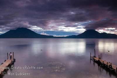 Guatemala Mission Trip - Day 5 -  Tuesday, November 13, 2007 Sunset over Lake Atitlan from Panajachel, Guatemala.   Toliman Volcano with Atitlan Volcano behind it on left, San Pedro Volcano on right.