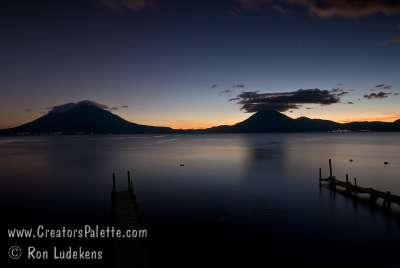 Guatemala Mission Trip - Day 6 - Wednesday, November 14, 2007<br /> Sunset over Lake Atitlan from Panajachel, Guatemala.   San Pedro Volcano on right with interesting cloud. City of San Pedro beside it.  Toliman Volcano with Atitlan Volcano behind it on left.  Sliver of moon starting to appear.