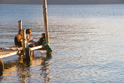 Guatemala Mission Trip - Day 6 - Wednesday, November 14, 2007  As sun begins to set, youth sitting on dock over Lake Atitlan in Panajachel, Guatemala.