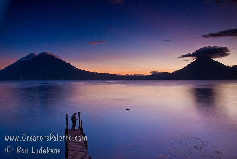 Guatemala Mission Trip - Day 6 - Wednesday, November 14, 2007<br /> Sunset over Lake Atitlan from Panajachel, Guatemala.   San Pedro Volcano on right with interesting cloud and Toliman Volcano with Atitlan Volcano behind it on left.