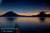 Guatemala Mission Trip - Day 6 - Wednesday, November 14, 2007<br /> Sunset over Lake Atitlan from Panajachel, Guatemala.   San Pedro Volcano on right with interesting cloud and Toliman Volcano with Atitlan Volcano behind it on left.  Sliver of moon starting to appear.