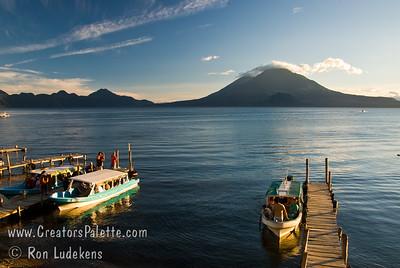 Guatemala Mission Trip - Day 6 - Wednesday, November 14, 2007 Late afternoon lake tours about to begin on Lake Atitlan in Panajachel, Guatemala.   Toliman Volcano with Atitlan Volcanoe behind it.