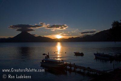 Guatemala Mission Trip - Day 6 - Wednesday, November 14, 2007 Sunset over Lake Atitlan from Panajachel, Guatemala.   San Pedro Volcano in silhouette across the lake.