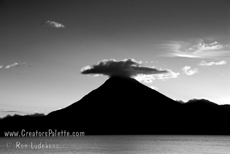 Guatemala Mission Trip - Day 6 - Wednesday, November 14, 2007<br /> Sunset over Lake Atitlan from Panajachel, Guatemala.   San Pedro Volcano with interesting cloud in background.