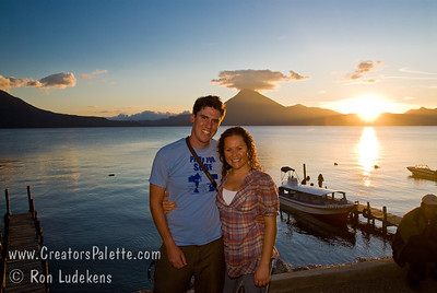Guatemala Mission Trip - Day 6 - Wednesday, November 14, 2007 Collette and Tanner in front of Sunset over Lake Atitlan from Panajachel, Guatemala.  San Pedro Volcano in background.