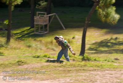 Guatemala Mission Trip - Day 6 - Wednesday, November 14, 2007 Guatemalan man carrying a log from a tree freshly cut down by machete.