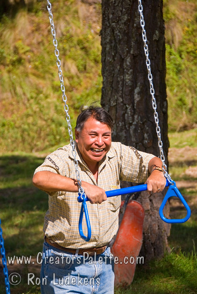 Guatemala Mission Trip - Day 6 - Wednesday, November 14, 2007<br /> Time to play on the playground equipment.  Local children (from family with cow) helped break it in.  Samuel got involved too - was this a safety check?  Well it held up fine.
