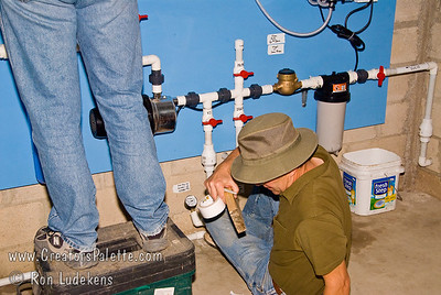 Guatemala Mission Trip - Day 6 - Wednesday, November 14, 2007 David is labeling the valves and water flow directions.