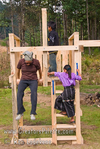 Guatemala Mission Trip - Day 6 - Wednesday, November 14, 2007 Time to play on the playground equipment.  Local children (from family with cow) helped break it in.  Colette trying out the equipment too.  Not sure who is younger at heart.
