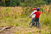 Guatemala Mission Trip - Day 7 - Thursday, November 15, 2007.  Dedication Day.<br /> Local boys riding their bike through the camp on the trail.