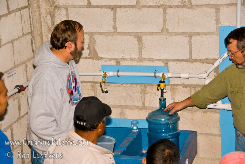 Guatemala Mission Trip - Day 7 - Thursday, November 15, 2007.  Dedication Day.<br /> Full demonstration of Clean Water System to third of three groups.  This group made up of many family member and wives also was very interested and asked questions.