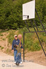 Guatemala Mission Trip - Day 7 - Thursday, November 15, 2007.  Dedication Day.<br /> Bruce helping a young boy learn to shoot hoops.