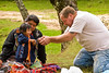 Guatemala Mission Trip - Day 7 - Thursday, November 15, 2007.  Dedication Day.<br /> Interacting with family around their cooking fire.  Mike playing tug-o-war with child.  The child won.