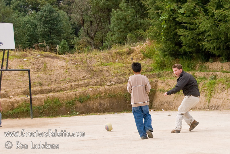 Guatemala Mission Trip - Day 7 - Thursday, November 15, 2007.  Dedication Day.<br /> Tanner playng soccer on the basketball court with some children.