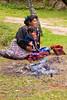 Guatemala Mission Trip - Day 7 - Thursday, November 15, 2007.  Dedication Day.  <br /> Mother and child by the cooking fire.