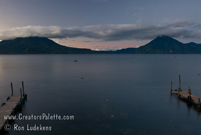 Guatemala Mission Trip - Day 7 - Thursday, November 15, 2007 Sunrise on Lake Atitlan in Panajachel, Guatemala.   Toliman Volcano with Atitlan Volcano behind it on left, San Pedro Volcano on right.