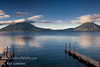 Guatemala Mission Trip - Day 7 - Thursday, November 15, 2007<br /> Sunrise on Lake Atitlan in Panajachel, Guatemala.   Toliman Volcano with Atitlan Volcano behind it on left, San Pedro Volcano on right.