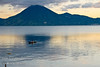 Guatemala Mission Trip - Day 7 - Thursday, November 15, 2007<br /> Sunrise on Lake Atitlan in Panajachel, Guatemala.  Local fisherman in his boat made of planks.  He did a lot of bailing water.   San Pedro Volcano on far shore.