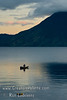 Guatemala Mission Trip - Day 7 - Thursday, November 15, 2007<br /> Sunrise and Early morning on Lake Atitlan in Panajachel, Guatemala.  Local fisherman in his boat made of planks.  He did a lot of bailing water.   San Pedro Volcano on far shore.
