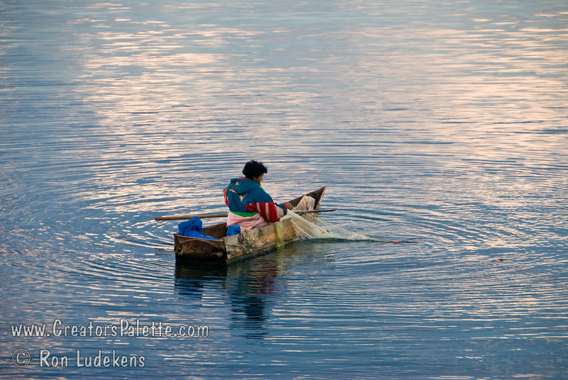 Guatemala Mission Trip - Day 7 - Thursday, November 15, 2007<br /> Early morning on Lake Atitlan in Panajachel, Guatemala.  Local fisherman using fishing nets in his boat made of planks.  He did a lot of bailing water.