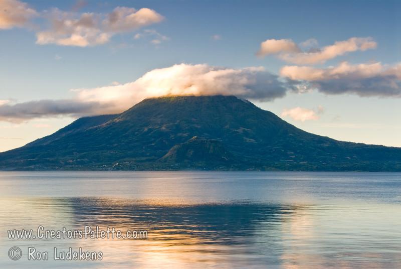 Guatemala Mission Trip - Day 7 - Thursday, November 15, 2007<br /> Sunrise on Lake Atitlan in Panajachel, Guatemala.   Toliman Volcano with Atitlan Volcano behind it
