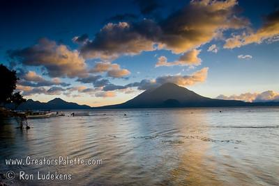 Guatemala Mission Trip - Day 7 - Thursday, November 15, 2007 Sunset over Lake Atitlan from Panajachel, Guatemala.   Toliman Volcano with Atitlan Volcano behind it.